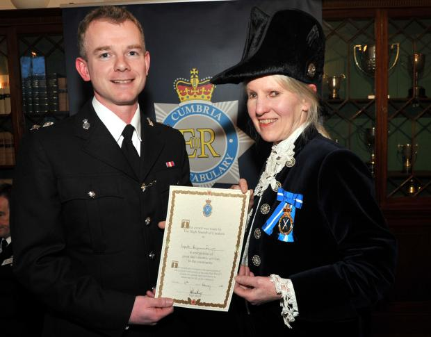 LIFE SAVER: Insp Ben Swinson receives award from the High Sheriff of Cumbria Diana Matthews