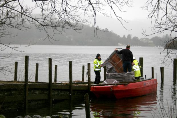 WHEN THE BOAT COMES IN: Staff from Richards of Kendal load up for one of more than ten removal trips from Derwent Isle