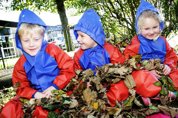 Flookburgh pupils Jake Wilson, Archie Gribble and Emma Nelson take time out in the school's wildlife area