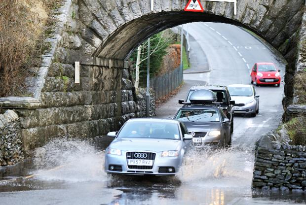 Drivers negotiate the flooding at Parkside Road