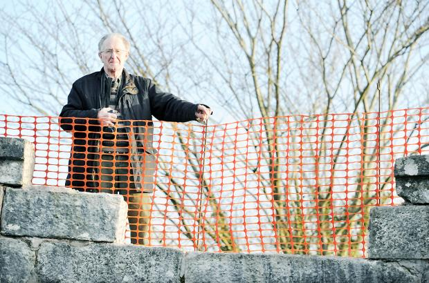 ACTION DEMAND: Local resident Frank Sanderson at the damaged Crooklands Bridge