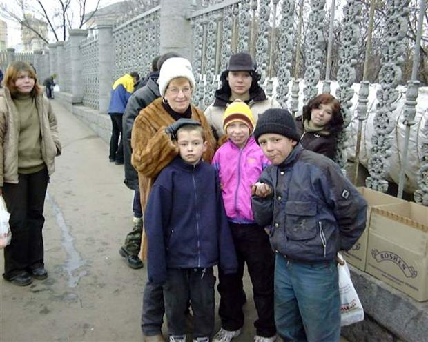 CONCERN: Pat Harrison, of Kendal, with some Ukrainian children