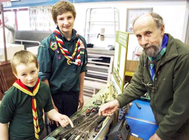 Former district chairman Norman Dray, who had the winning layout at the Scout Rail Fair in Settle, with Tom Lothian and William Arber from Settle Scouts and Cubs