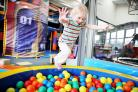 Jorja Rogan, two, from Dalton, leaps into the ball pool at the new play centre