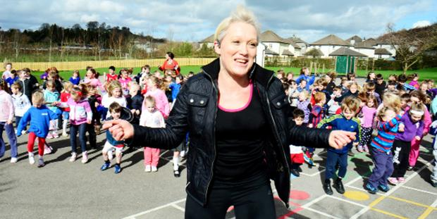 The Westmorland Gazette: Simone Mattinson leads enthusiastic youngsters at Kendal's Heron Hill primary school in a 'Boxercise' session