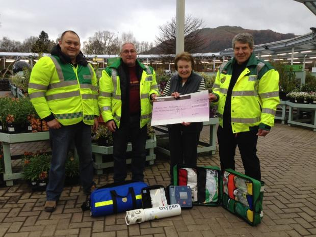 Garry Haywood, Barry Potter and Nick Martin receive their donation from Elizabeth Hayes