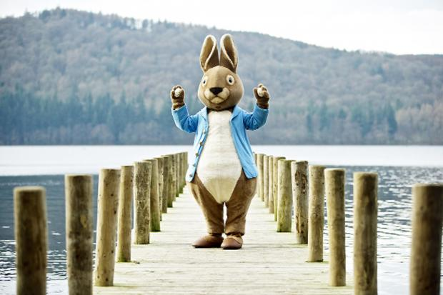 Peter Rabbit at Windermere with two of the eggs, designed by local artist Sue Dunne