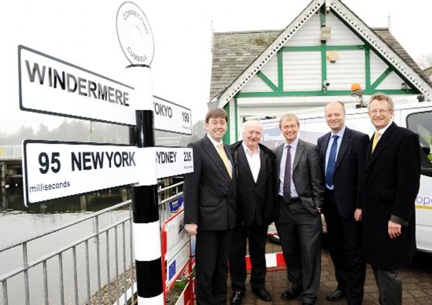 The Westmorland Gazette: From left, Brendan Dick of BT, Bill Jefferson of the National Park Authority, Tim Farron MP, Jim Jackson of BT, and Coun Jo Stephenson, with a signpost at Bowness showing web connection times to the world's major cities