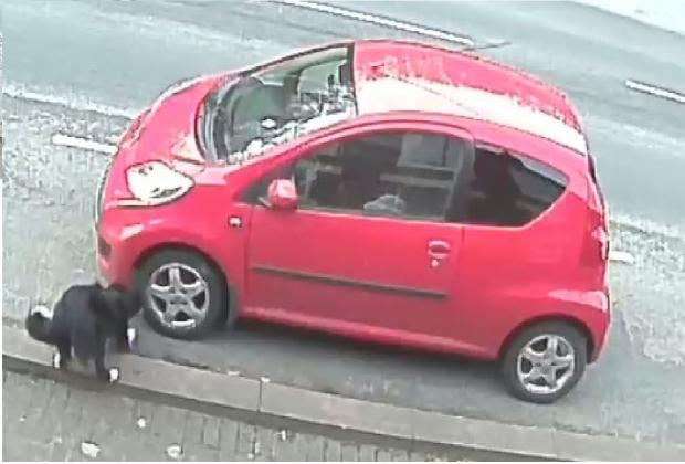 Caught on CCTV: Jess takes a dislike to car tyres
