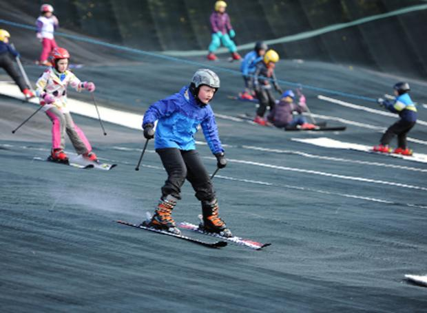 Children concentrate on making the finish during the ski races