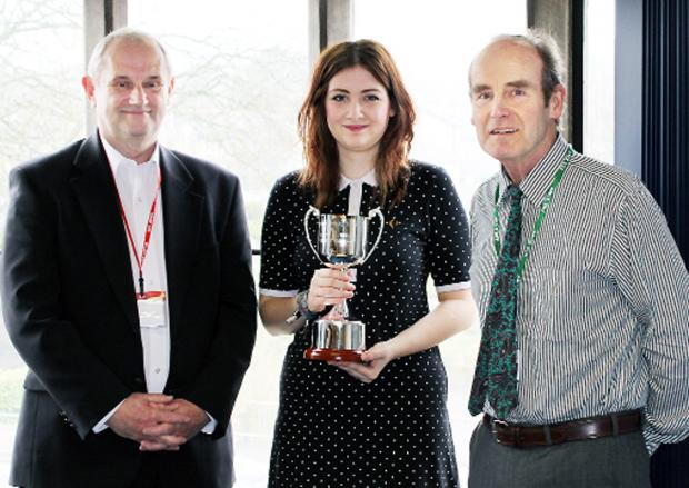 Evie receives her prize from Geoff Cater, left, and John Dawson
