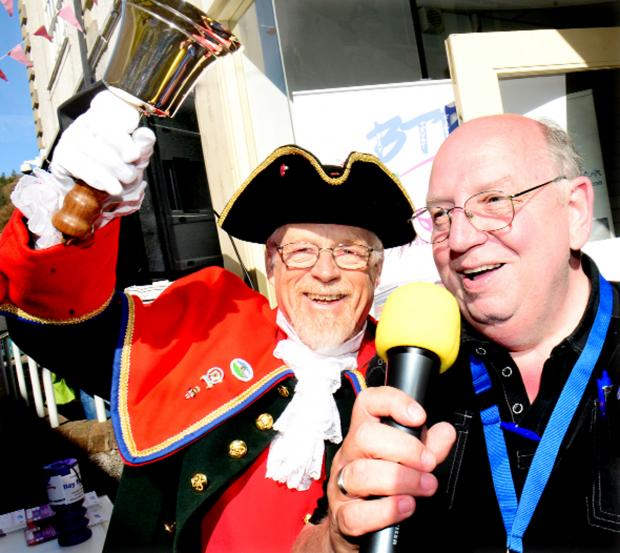 Kendal town crier Richard Mathews with John Williamson, president of Bay Trust Radio, at the launch of the 60-hour event to raise funds for the station