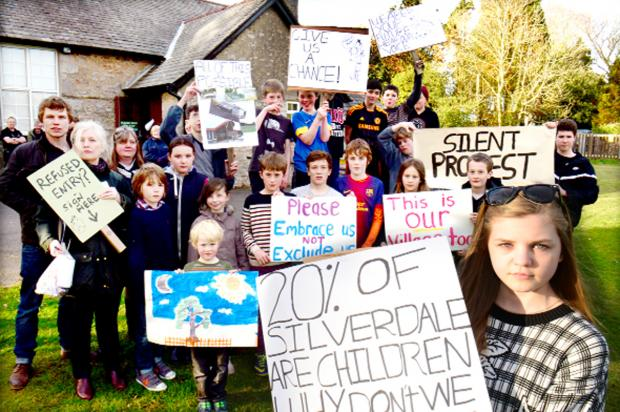 Youngsters with their signs and posters outside Silverdale Village Institute on the night of the meeting