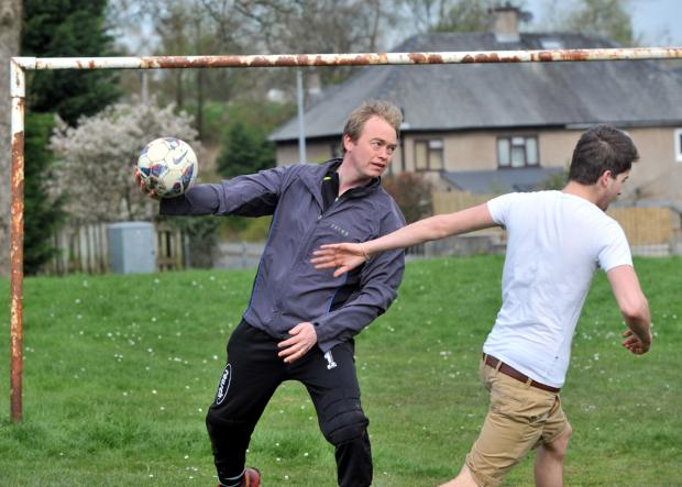 Mr Farron dons the goalie gloves for a kickabout recently