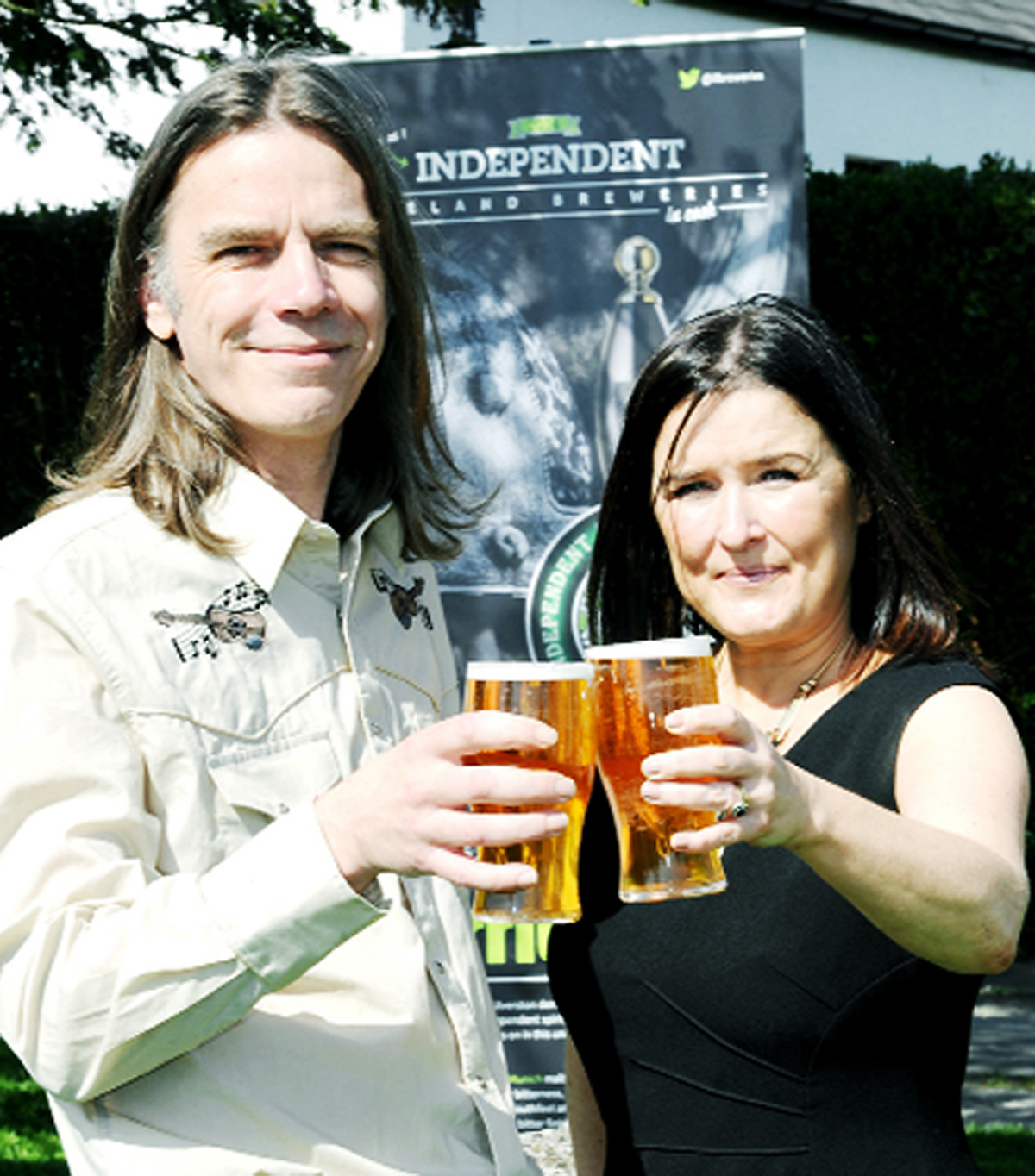 Brewer Jon Kyme with partner Becky Stringer of the award-winning Stringers Beer toast their Wolf Warrior ale
