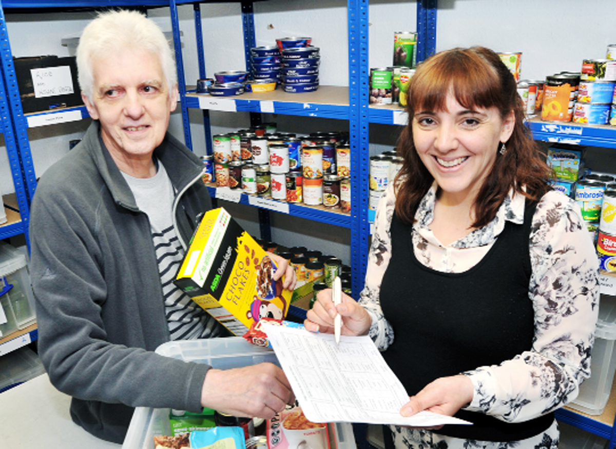 Delivery co-ordinator Alastair Sutherland and  Rachel Ellis at the food bank