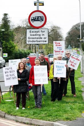 Members of Westmorland Labour Party take part in a protest at Greenside, Kendal