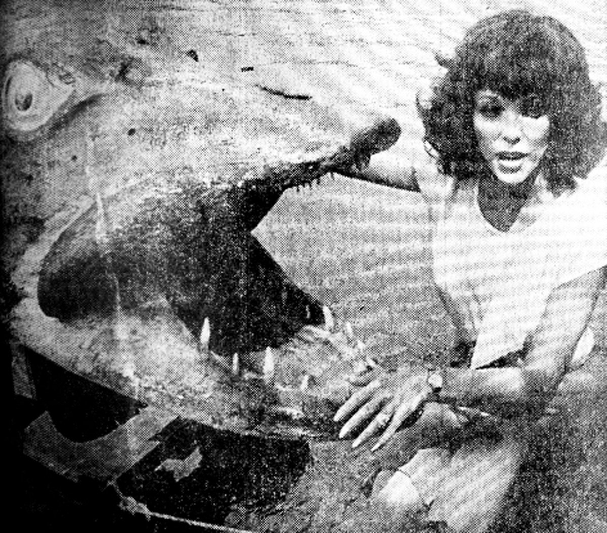 Joan Collins with the giant mechanical pike