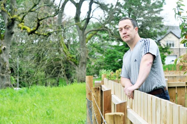 Sean Murphy looking out from his garden towards where the proposed footpath would be located