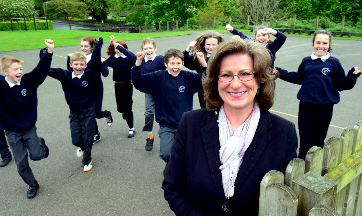 Helen Richardson, head teacher at Kendal's Castle Park School, celebrates the 'good' Ofsted verdict on the school with pupils