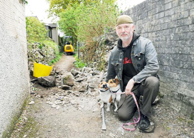 Local resident and dog owner Peter Nicholson at the site of the now demolished stile
