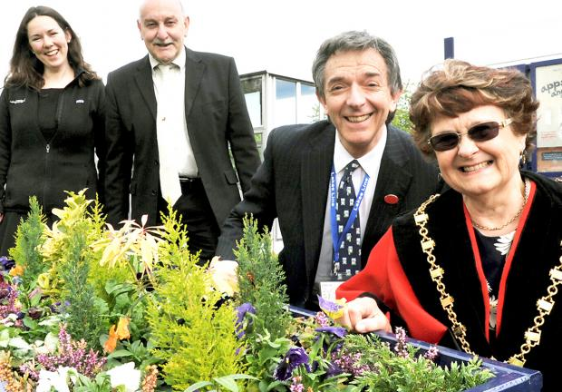 L-R Travel adviser Emma Moody, Geoff Cook of Kendal In Bloom, Robert Talbot of the Lakes Line Rail User Group, and Kendal Mayor Sylvia Emmott