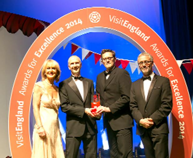 The Westmorland Gazette: Mountain Festival  directors Clive Allen and Steve Scott, centre, receive the award from VisitEngalnd's Viscountess Cobham