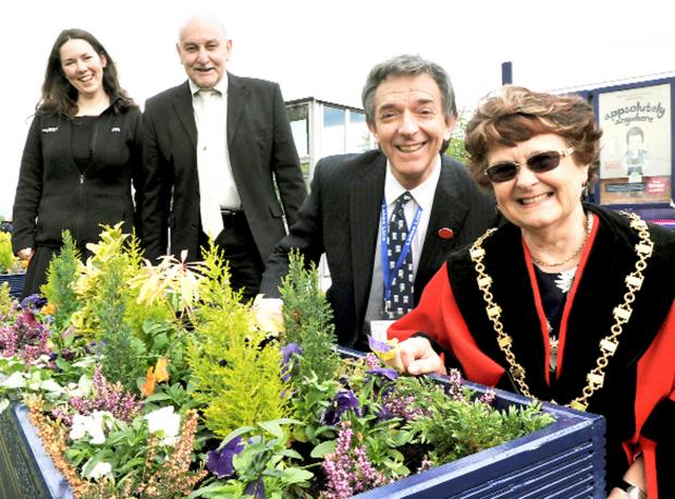 BLOOMING GREAT: Welcoming the new planters at Kendal railway station are, left to right, travel advisor Emma Moody, Geoff Cook of Kendal in Bloom, Robert Talbot, of the Lakes Line Rail User Group and Mayor Sylvia Emmott
