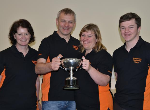Alan and Christine hold the trophy they won in Glasgow, flanked by first-aid team colleagues Nikki Brown and Josh Fitzgerald
