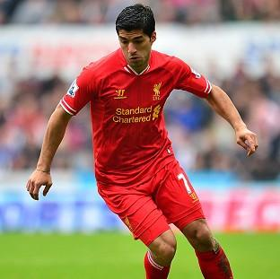 Luis Suarez insists he is happy at Liverpool