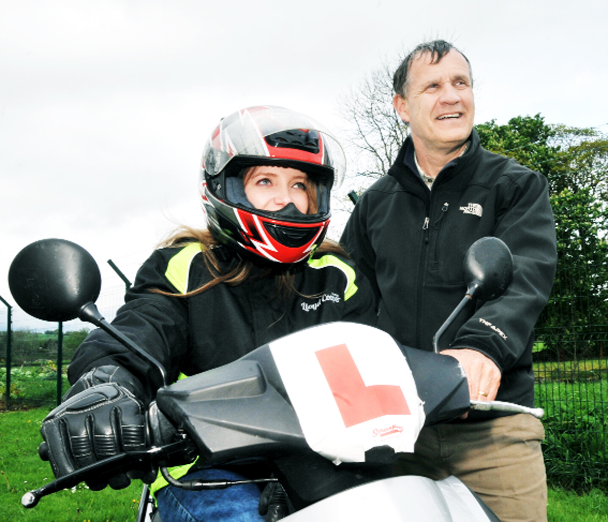 Asher Hamilton on her scooter with Pete Armitage of Inspira