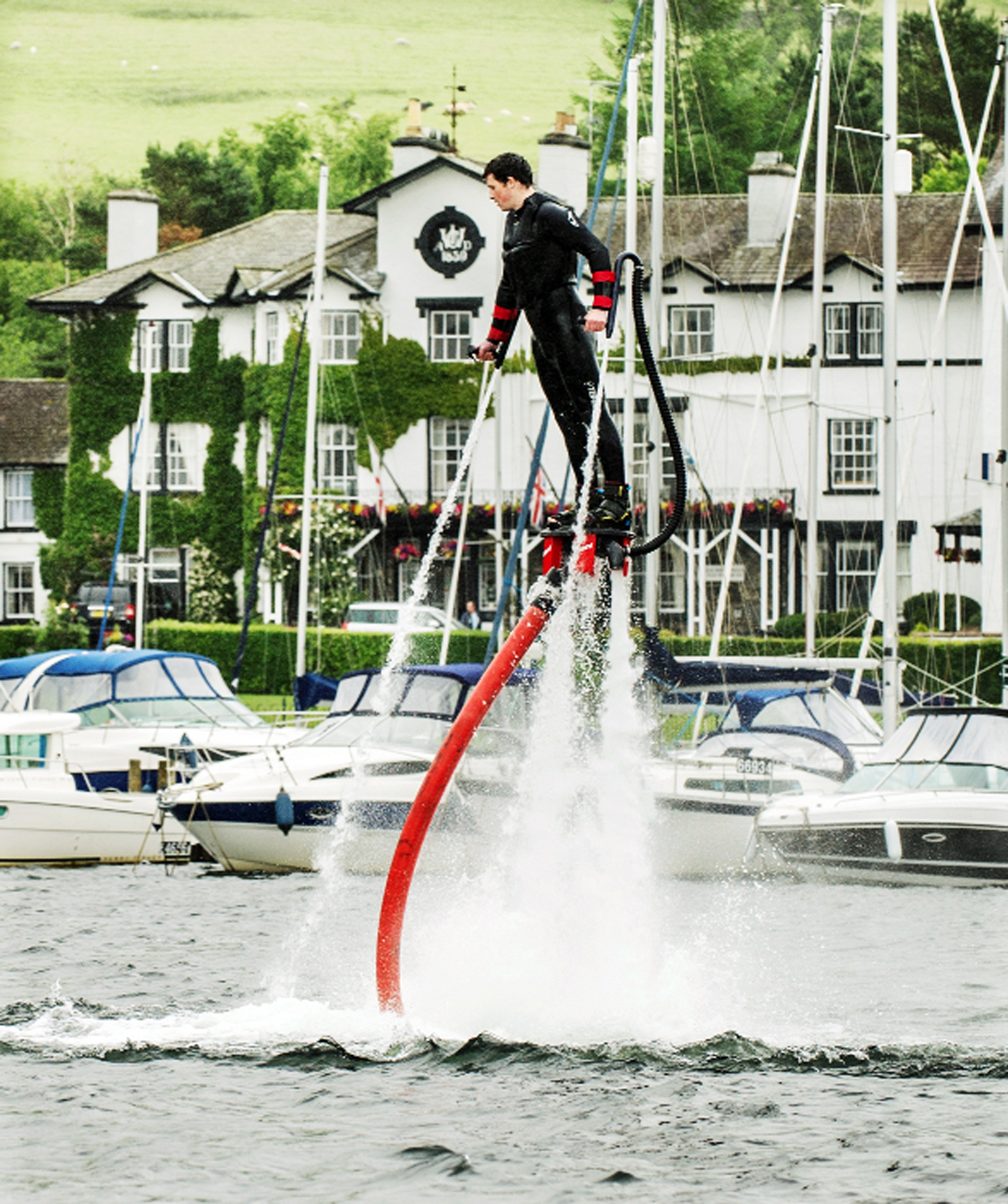 A rider demonstrates the art of flyboarding in a special session at Low Wood Bay, Ambleside