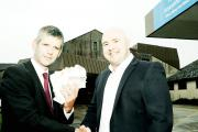 Andrew Thomas  of The Westmorland Gazette (left) gives the coupons to Aaron Cummins, deputy chief executive of the University Hospitals of Morecambe Bay NHS Trust
