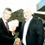 The Westmorland Gazette: Andrew Thomas  of The Westmorland Gazette (left) gives the coupons to Aaron Cummins, deputy chief executive of the University Hospitals of Morecambe Bay NHS Trust