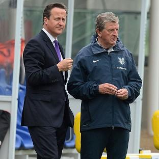 David Cameron, left, met Roy Hodgson at Burton