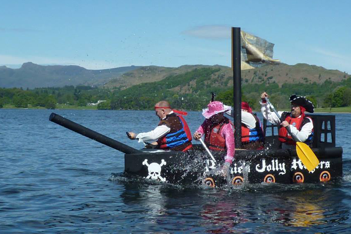 Disabled children and their families to benefit from £4,000 raised during cardboard boat race on Windermere