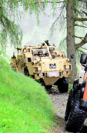 Army vehicles patrol the Lake District