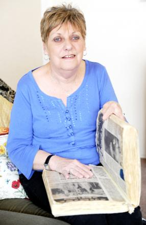 Wendy Dowbiggin with a scrapbook kept by her mother of the Gazette and Craven Herald cuttings