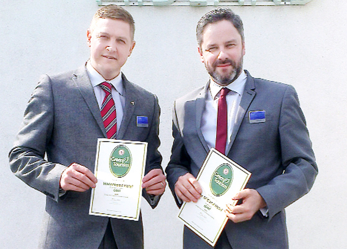 Mark Needham, left, from Waterhead, and Matt Stanaway, from The Midland, display their Gold Green Business Tourism Awards