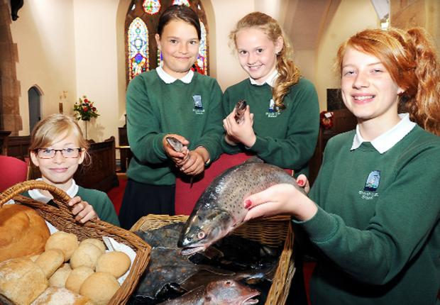 Christians gather for blessing of loaves and fishes