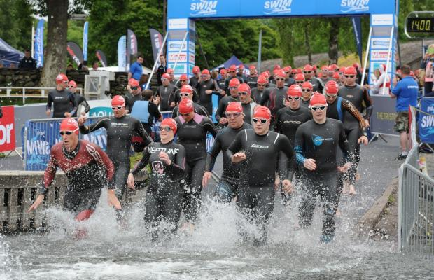 Swimmers setting off on one of the first races