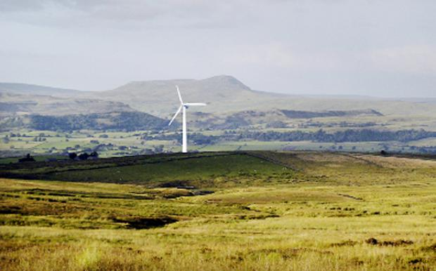 A photo montage by Eldroth resident Roland Fudge of how the proposed win turbine could look, with Pen-y-ghent behind it, and Fountains Fell to the right