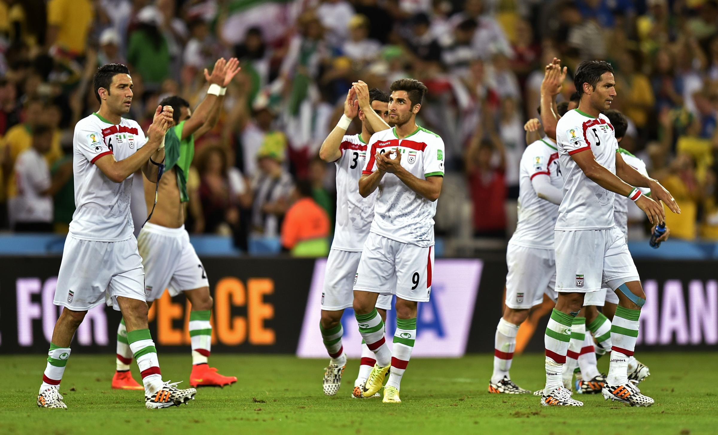 Iranian players applaud the crowd after the group F World Cup soccer match between Iran and Nigeria at the Arena da Baixada in Curitiba, Brazil