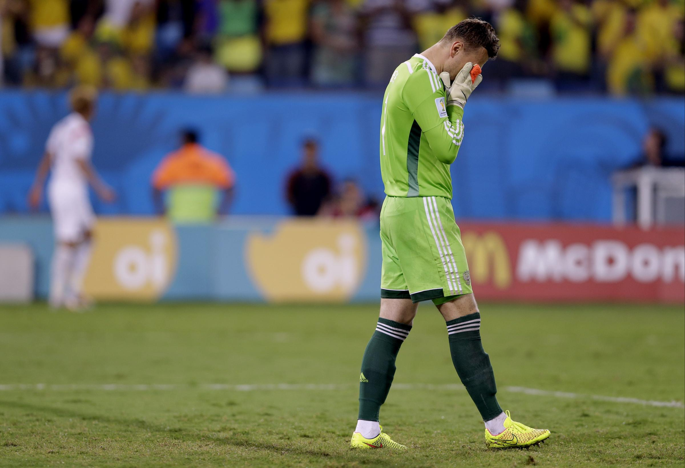 Russia's goalkeeper Igor Akinfeev reacts after letting in the opening goal