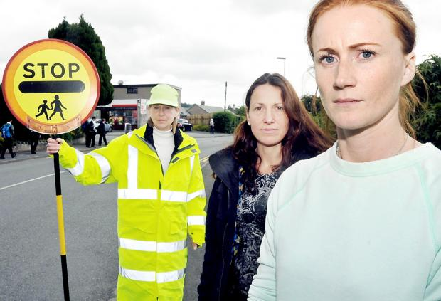 Lollipop lady Janet Beaty with parents Penny Irvine and Lyndsey Goodyear