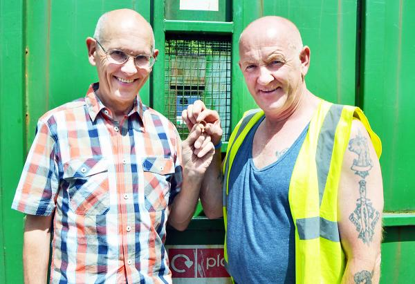 L-R: David Taylor gets the ring back from Josh Waite of Cumbria Waste Group