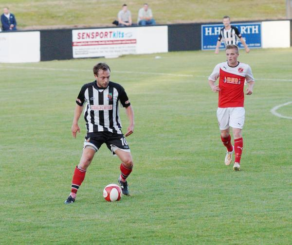 Returning striker Mark Jackson insists nothing but promotion will do for Kendal Town this season