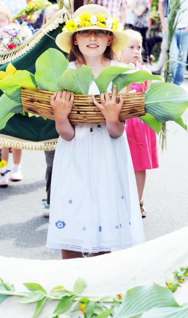 The Westmorland Gazette: This youngster gets into the spirit of the rushbearing. Pic by Allan Bovill