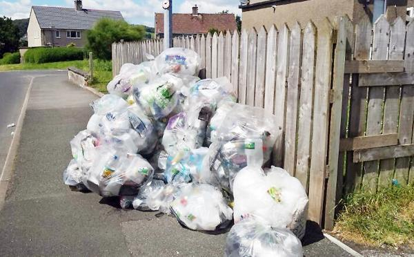 Bags of rubbish piled up against John Driscoll's garden fence at Kentmere Brow, Kendal