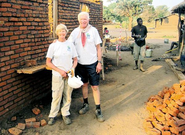 Retired nurse Ann Keene, pictured with her late  husband Peter during a previous trip, has jetted off to Africa to help orphan families